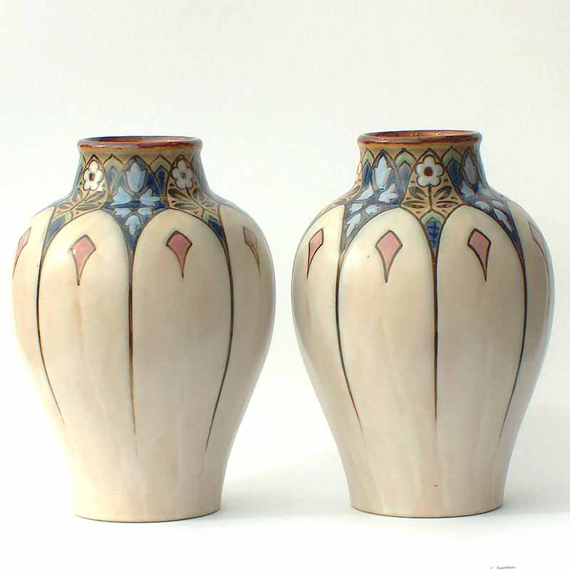 Pair of |Royal Doulton Art Deco stoneware vases (probably Francis C Pope)
